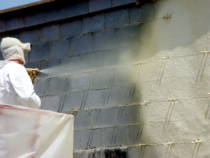 spraying-on-building